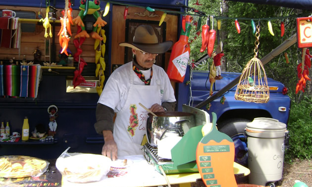 Bob Braisher prepares tasty chili at the 2009 Spilli Chilli cookoff in Spillimacheen.