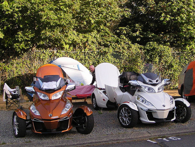 Gleaming bronze and creamy-white version Spyders sitting outside of a tent in Vancouver