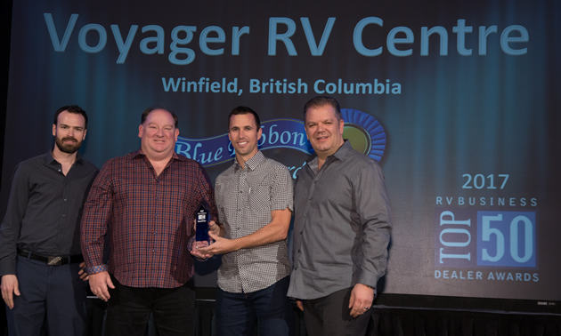 Voyager RV managers receive industry recognition: (L to R)  Logan Walker, Ward Fraser, Jason Friesen (vice-president) and Mike Roberts.