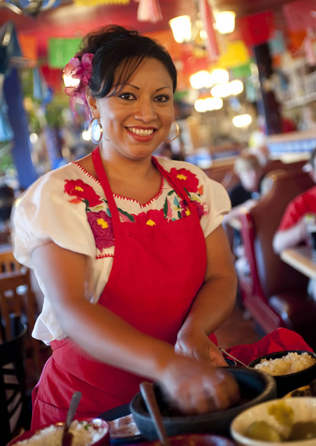 A woman making some traditional Mexican food in Tucson, Arizona.