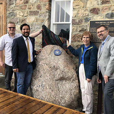 Minister Miranda, MLA Piquette and members of the Highland Community Hall of Barich Society and Smoky Lake County officials celebrate designation of the Ukrainian Farmers' National Home of Taras Shevchenko (Highland Hall) as a Provincial Historic Resource.
