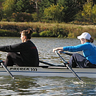 Two women rowing a boat through Vermilion.