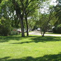 Green lawn and shade trees at River Park Campground in Moose Jaw, SK