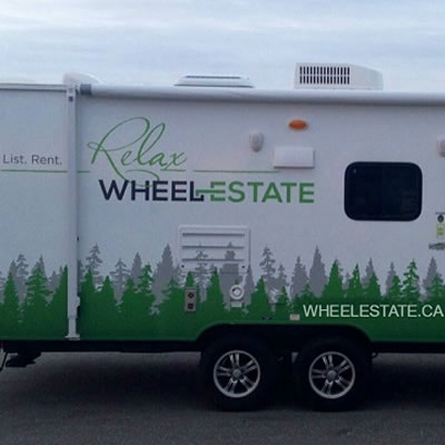 Trailer with Wheel Estate graphics/info on it.