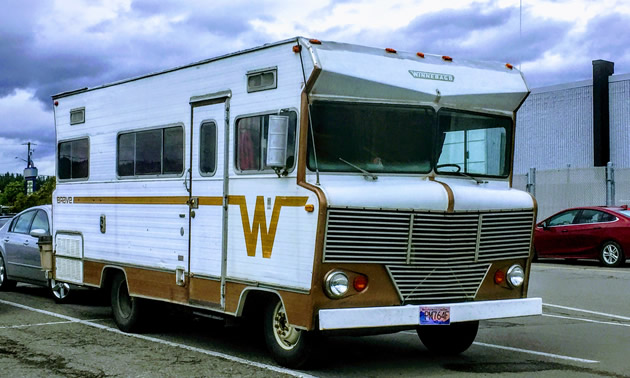 Winnebago Brave parked in parking lot.