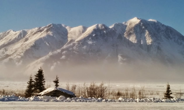 The sun shines on the mountains of Kluane National Park, Yukon