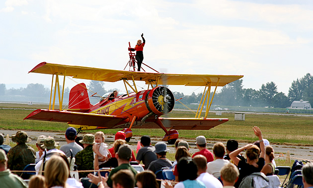 person standing on top of an aircraft at the Abbotsford Air Show
