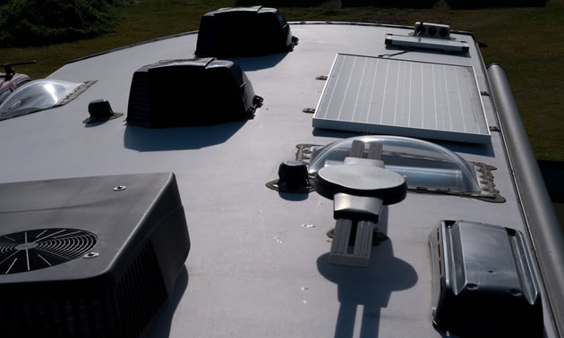 This is the top of the author's trailer, showing the air conditioner, solar panel and vents with covers.