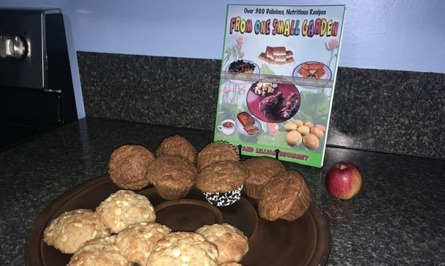 muffins on a plate in front of a cook book