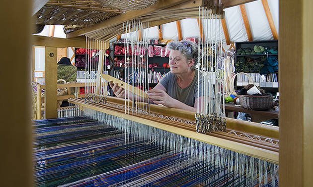 lady at a loom making crafts at Madeira park, BC