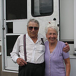 elderly couple in front of a motorhome