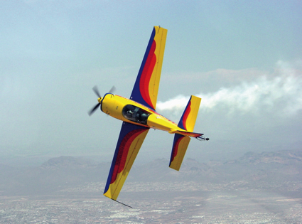 A aerobatic airplanes twists through the air.