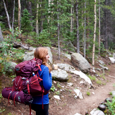 A backpacker hikes in Golden Gate Canyon State Park in Colorado.