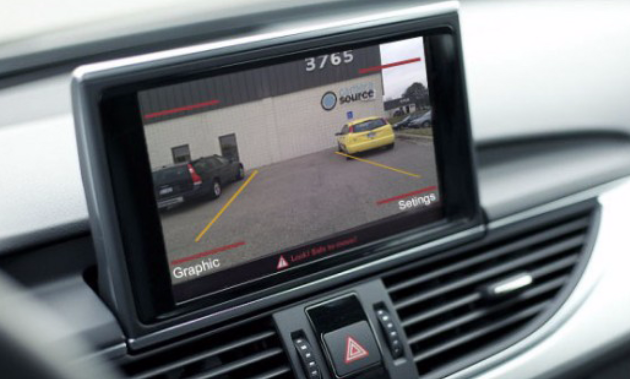 A backup camera mounted on a dashboard