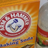 A photo of a box of baking soda and a bottle of vinegar