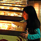 Girl playing on a pinball machine