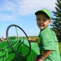 child riding a tractor in Beaver County's agri tourism event