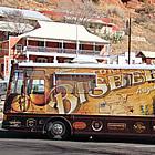 Motorhome parked beside a mountainside