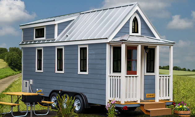 Picture of blue tiny house RV unit.
