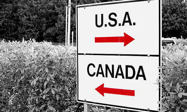 sign with USA and Canada with arrows pointing each way