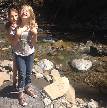 Michelle Carr's daughters standing next to Boulton Creek.