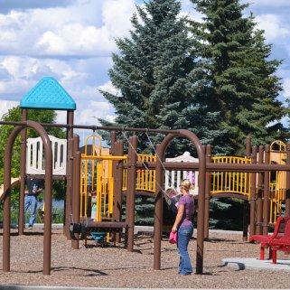 Children have fun at the playground in Fred Johns Park, Leduc, AB. Photo by