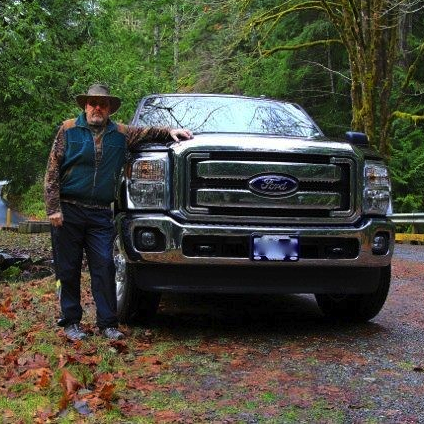 Man standing beside a truck