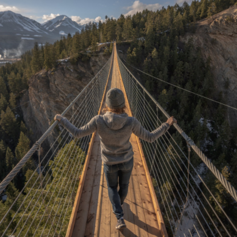 lady walking on a suspension bridge