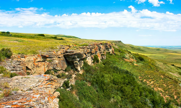 A cliff that served as a buffalo jump for First Nations is commemorated at Head-Smashed-In Buffalo Jump near Fort Macleod, Alberta.