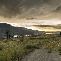 Summer sunrise on Kamloops lake. this is the BC desert country, driving from Cache Creek on Highway 97 there was lots of rain during the spring so the sage and grass were still green. the yellow flowers were still blooming as well.