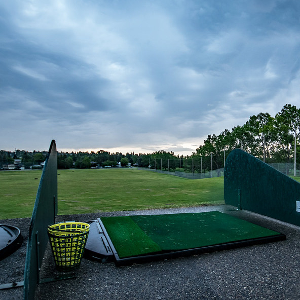 A photo of the Confederation Park Golf Course in Calgary, showing the driving range.