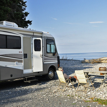 The Elliott's rig parked on the beach at St. Ann's Bay Campark, Cape Breton, NS.