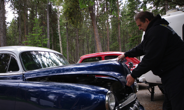 Bob Hielmeier closing the hood os his '52 Chevy