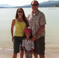 Carla, Brian and Tailia Rogoza standing in front of Invermere Lake.