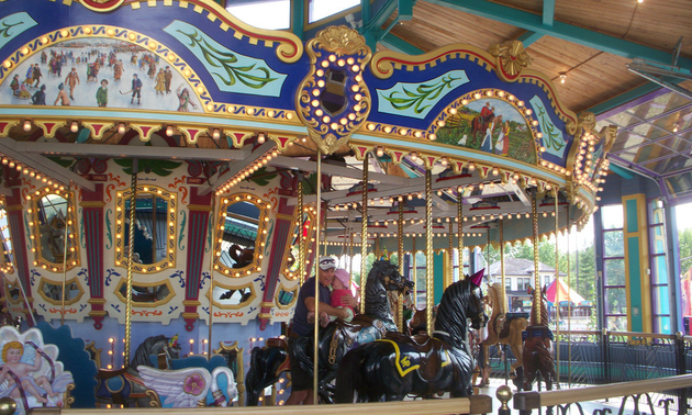 an elaborately hand-carved carousel
