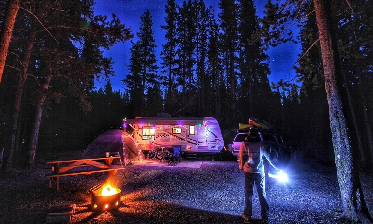 A campsite set up at night with lights