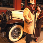 classic car with two people standing in '20s attire