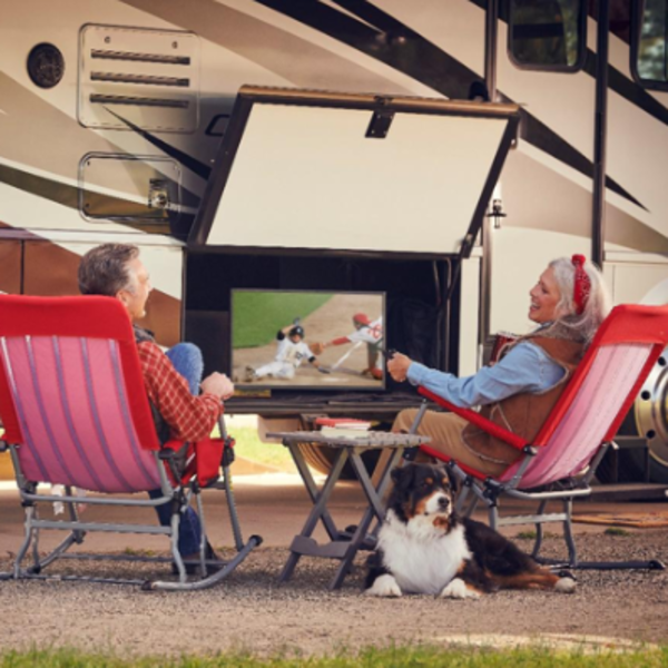 people sitting in front of their RV