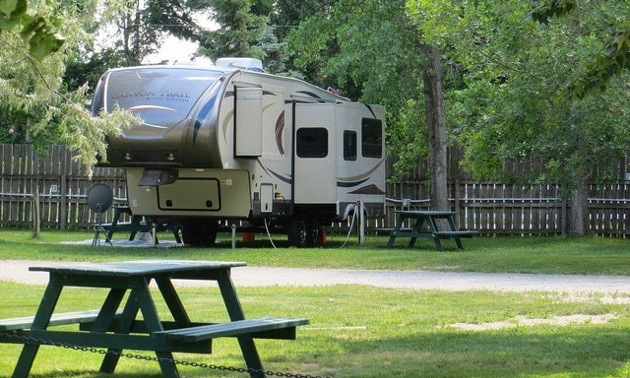 A 5th wheel parked at the Daisy May Campground and RV Resort in For Macleod, AB