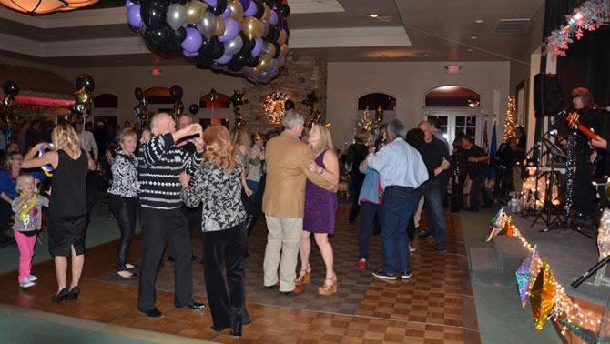 Group of people dancing in ballroom