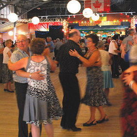 Dozens of couples dancing on the hardwood floor of Danceland.
