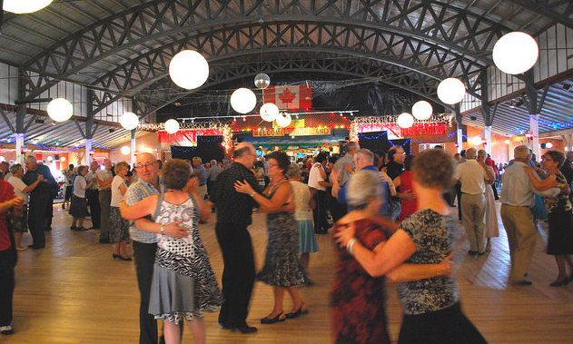 Dozens of couples dancing on the hardwood floor of Danceland.