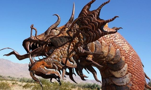 A steel-welded sculpture of a serpent head.