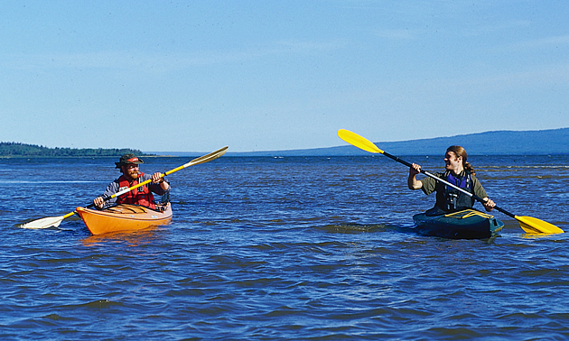 two people kayaking on an Alberta body of water