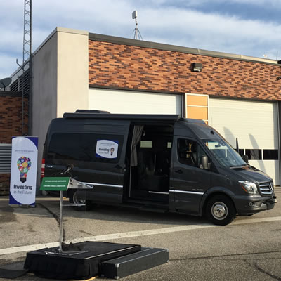 Picture of black Erwin Hymer van in parking lot.