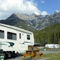 An RV parked at Fairmont RV park, with a view of the mountains in the background.