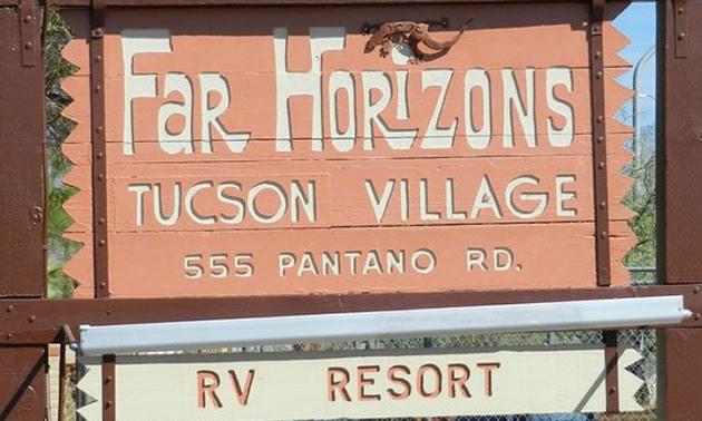 Far Horizons Tucson Village RV Resort sign.