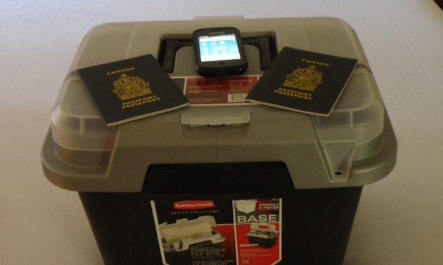 fireproof box, passports, cell phone