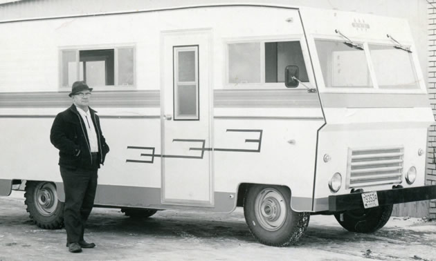 One of the first Triple E motorhomes ever built, with man standing in front of it.