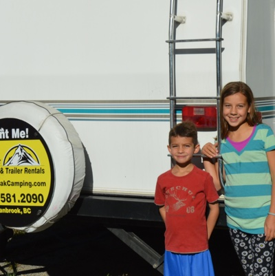 Daphne and Oliver Gonzalez standing next to their rented 28' Vanguard RV.